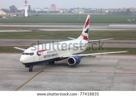 BOLOGNA - OCTOBER 16: Boeing 737 of British Airways on October 16, 2010 at Bologna Airport, Italy. Although B737 is successful, British Airways is replacing its fleet with Airbus A320 family. - stock photo