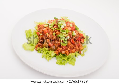 bolognese spaghetti, minced pork tomato sauce pasta on white dish,Fried noodles with tomato sauce and minced pork   - stock photo