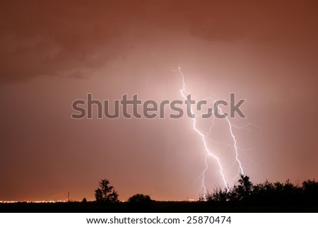 Bolt of lightning in a red sky.