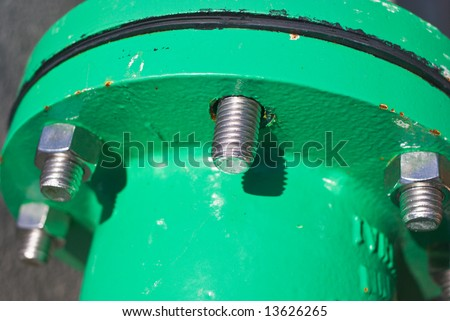 Bolted Cast Iron Pipe Flange with Missing Nut - stock photo