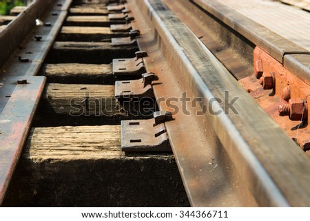 Bolts hold Railway on wooden - stock photo