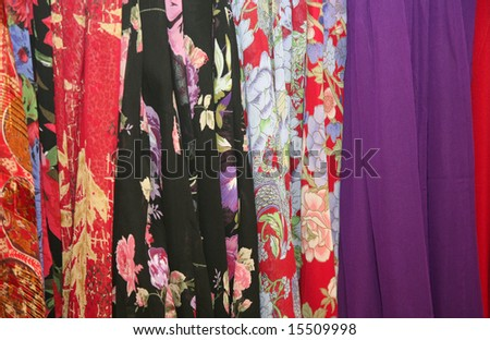 Bolts of cloth or textile at a retail store make a pretty background - stock photo