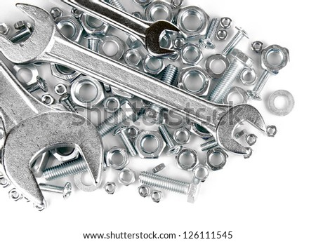 Bolts, screws, nuts, wrench isolated on white