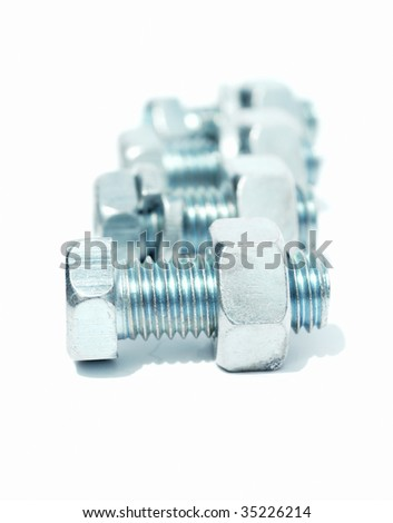 Bolts with nuts and washers - stock photo