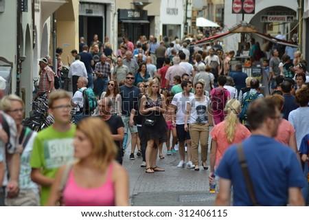 Bolzano, Italy - July 29, 2015: Tourists and shoppers fill the city of Bolzano during summertime - stock photo