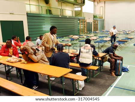 BOLZANO, ITALY - SEPTEMBER 16, 2015: Refugees on arrival in a refugee camp emergency in Italy. Rest of migrants in a refugee camp on September 16, 2015