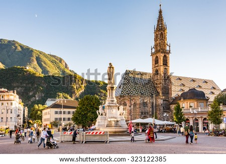 BOLZANO, ITALY - SEPTEMBER 20: Tourists at Walther Square in Bolzano, Italy on September 20, 2015. Bolzano is the largest city of South Tyrol. Foto taken from Walther Square. - stock photo