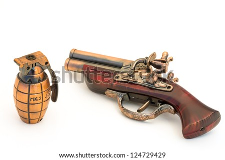 Bomb and wooden handle gun on white background