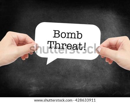Bomb threat written on a speechbubble - stock photo