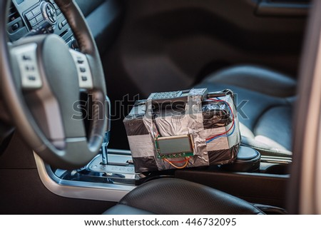 bomb with radio control and digital countdown timer lies in the car. terrorism and dangerous life concept