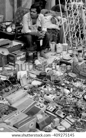 BOMBAY, INDIA - FEBRUARY 15, 1984: electronic equipment vendor at the biggest open air city market. The place is everyday populated by thousands of people.