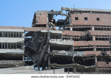 Bombed and abandoned  building of war.  Architecture ruins and destruction - stock photo