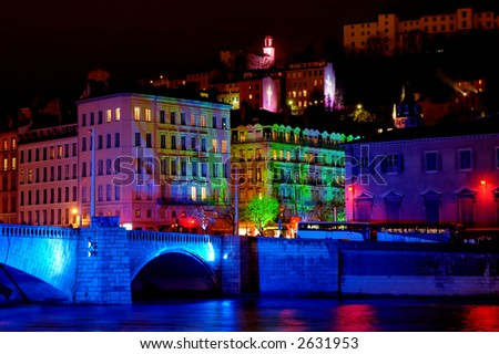 Bonaparte bridge and the old town (fourviere hill)  during light fest - stock photo