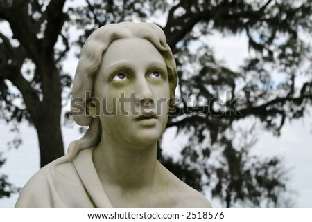 Bonaventure Cemetery Statue with Real Eyes. - stock photo