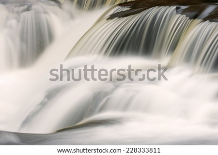 Bond Falls cascade captured with motion blur, Michigan's Upper Peninsula, USA  - stock photo