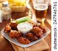 boneless buffalo bbq chicken wngs with ranch sauce and beer - stock photo