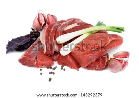 Boneless Raw Beef with Basil, Spring Onion, Garlic and Pepper Corn isolated on white background