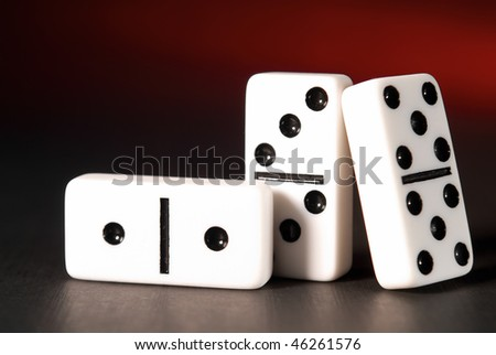 Bones of a dominoes on color background - stock photo