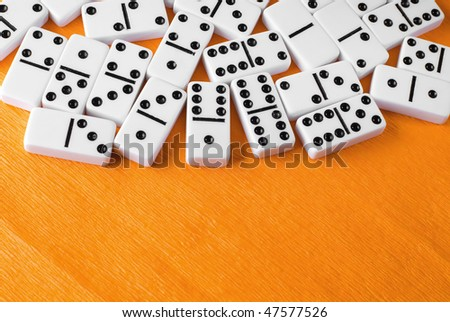 Bones of a dominoes on color background