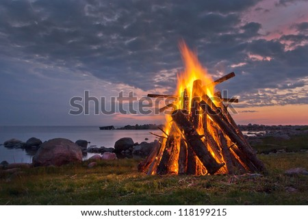 Bonfire in a white summer night - stock photo