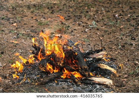Bonfire next to the tourist camp. Journey into the wild concept. - stock photo