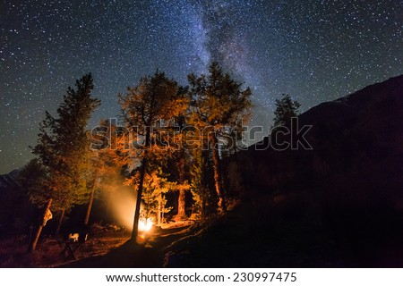 Bonfire on a background of the sky in the mountains - stock photo
