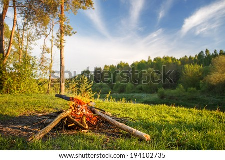 bonfire on summer evening - stock photo