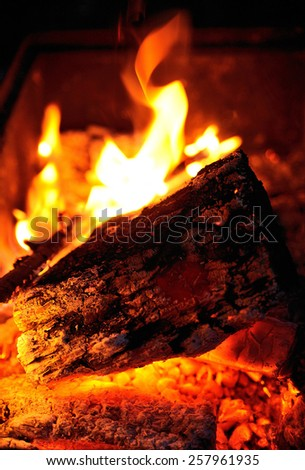 Bonfire with sparks at night time - stock photo