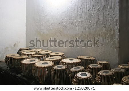 Bongo drums with old wall in background - stock photo