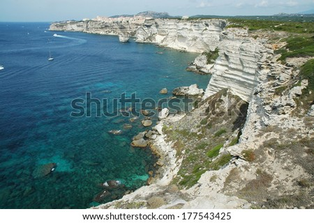 Bonifacio citadel on a cliff in the Corsican shoreline  - stock photo