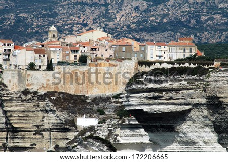 Bonifacio fortress on a cliff in the Corsican shoreline - stock photo