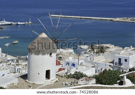 Bonis Windmill housing the Folklore Museum overlooking the town of Mykonos Greece. - stock photo