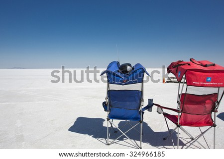BONNEVILLE SALT FLATS, UT, SEPTEMBER 8: Two empty chairs facing the racing field during World of Speed 2012 in Bonneville Salt Flats, blue sky in the background. USA 2012 - stock photo