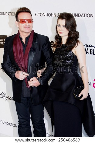 Bono and Eve Hewson at the 21st Annual Elton John AIDS Foundation Oscar Party held at the Pacific Design Center in West Hollywood on February 24, 2013.  - stock photo