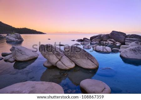 Bonsai rock at Lake Tahoe, dawn July 4th, 2012. - stock photo