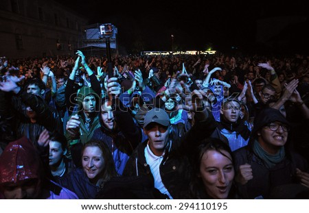 BONTIDA - JUNE 26, 2015: Crowd of partying people during a Fatboy Slim live concert at Electric Castle Festival on June 26, 2015 in the Banffy castle in Bontida, Romania - stock photo