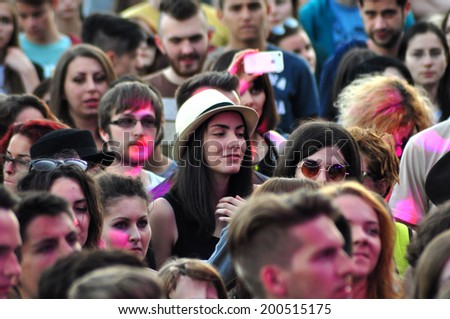BONTIDA - JUNE 19: Crowd of partying people during a live concert at Electric Castle Festival on June 19, 2014 in the Banffy castle in Bontida, Romania.  - stock photo