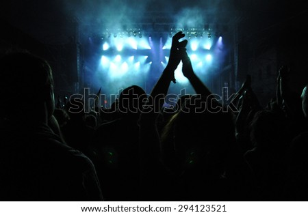 BONTIDA - JUNE 26, 2015: Partying crowd during the live concert of The Subways band from Great Britain at the Electric Castle Festival at June 26, 2015 in the Banffy castle in Bontida, Romania - stock photo