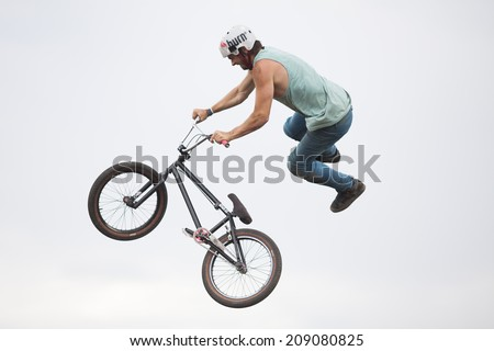BONTIDA - JUNE 21: Unidentified BMX rider making a bike jump during the BMX Competition, at Electric Castle Festival on June 21, 2014 in the Banffy castle in Bontida, Romania - stock photo
