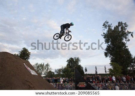 BONTIDA - JUNE 21: Unidentified BMX rider making a bike jump during the BMX Competition, at Electric Castle Festival on June 21, 2014 in the Banffy castle in Bontida, Romania