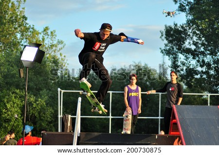 BONTIDA - JUNE 19: Unidentified skateboarder doing a slide trick during the Skateboard Competition at Electric Castle Festival on June 19, 2014 in the Banffy castle in Bontida, Romania - stock photo