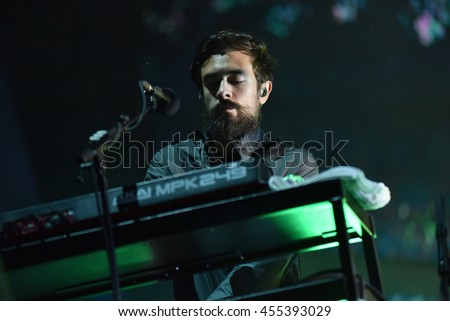 BONTIDA, ROMANIA - JULY 17, 2016: Keyboarder Kyle J Simmons of English band Bastille playing during a live performance at Electric Castle festival - stock photo