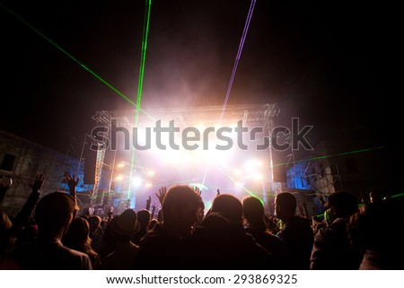 BONTIDA, ROMANIA - JUNE 28, 2015: Crowd of partying people at Electric Castle festival, one of the biggest music festivals in Romania.