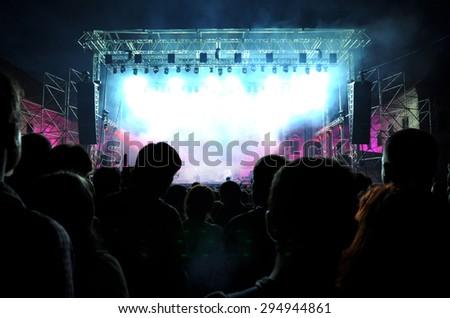 BONTIDA, ROMANIA - JUNE 28, 2015: Crowd of partying people at Electric Castle festival, the biggest electronic music festival in Romania - stock photo