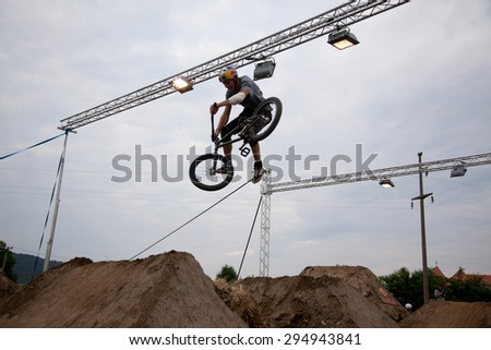 BONTIDA, ROMANIA - JUNE 27, 2015: Unidentified BMX rider making a bike jump during the BMX Competition, at Electric Castle Festival. - stock photo
