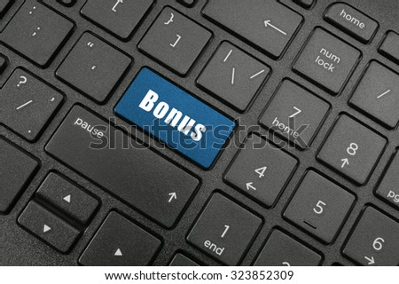 Bonus button on laptop computer keyboard
