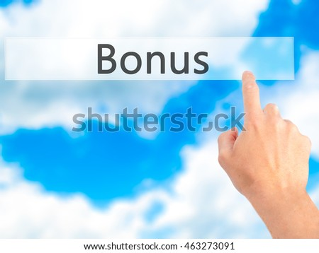 Bonus - Hand pressing a button on blurred background concept . Business, technology, internet concept. Stock Photo
