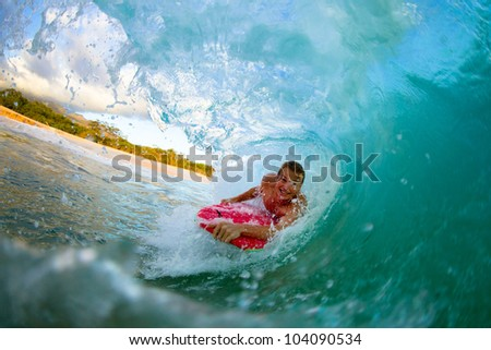 Boogie boarder riding a wave in the summer