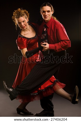 Boogie-voogie dancers on black background - stock photo