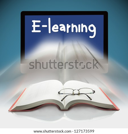 Book and computers, The concept E-learning - stock photo